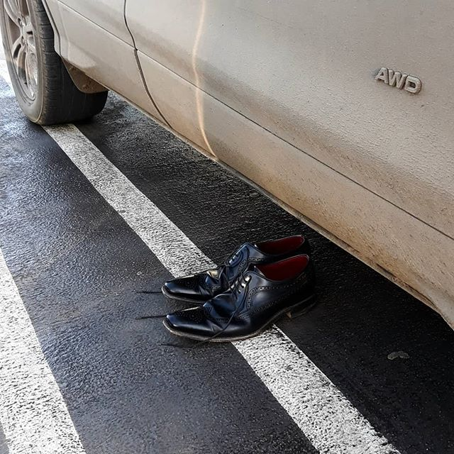 Went into Bicester shops this morning to park car to find this pair of shoes very neatly placed by one car; returned an hour later and they had moved to the next car and equally carefully placed... #weird #shoes #strangethingshappeninBicester