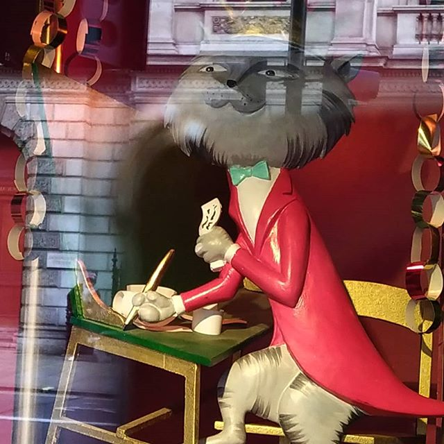 A writing cat in the @fortnums windows...